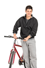 Casual man pushing a bicycle