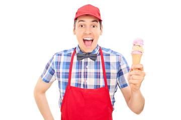 Cheerful vendor holding an ice cream