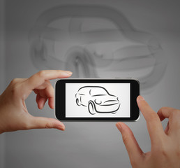 Smart hand using touch screen phone take photo of  Car icon as c