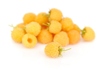 Fresh yellow raspberry on white background