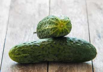 Fresh cucumbers close up on wooden background