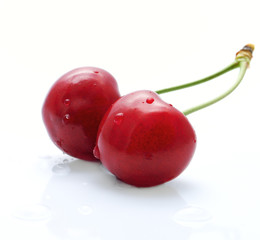 The couple of fresh beautiful cherries