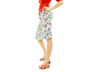 Woman wearing floral skirt and striped sandals