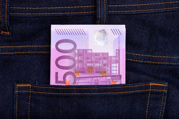Euro currency banknotes in jeans pocket