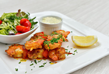 Brochettes with marinated and fried shrimps