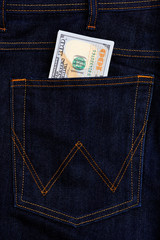 American dollars USD banknotes in jeans pocket