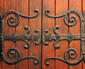 Wooden gates of a gothic style catholic church