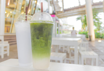 Iced green tea in plastic glass