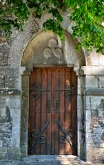 Door of church in Han-sur-Lesse, Belgium