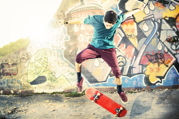Skater in movement making a trick with his skate