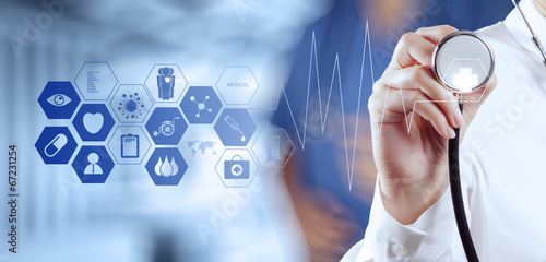 Medicine doctor hand working with modern computer interface - 67231254