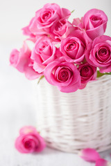 beautiful pink roses bouquet in basket