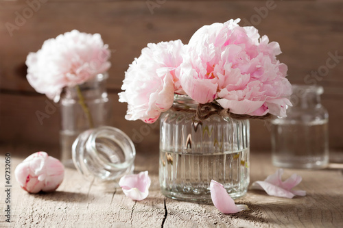 Fotobehang Bloemenwinkel beautiful pink peony flowers bouquet in vase