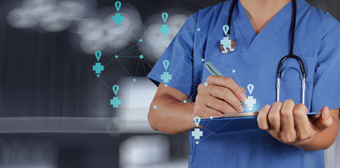 Medical Doctor working  with note board as medical network conce