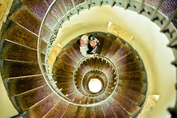 Young couple on a spiral staircase