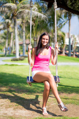 Happy woman on a swing
