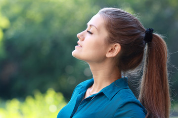 woman breathing fresh air