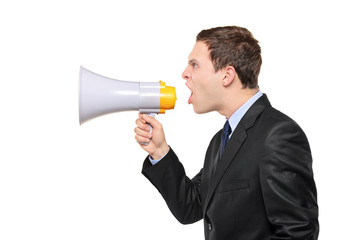 Young businessman shouting on a megaphone