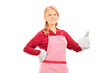 Woman with cooking gloves giving a thumb up