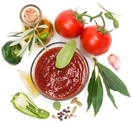 View from above of  bowl of tomato sauce with fresh ingredients