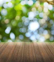 Wooden deck table over beautiful bokeh background