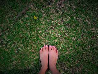 Feet standing on grass