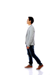 Full body side view of a fashion man walking forward