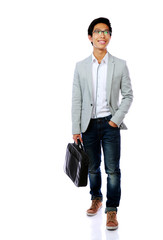 Happy asian man walking with briefcase over white background
