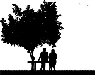Very old couple sitting on bench in park silhouette