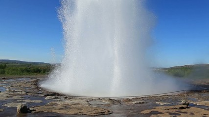 Famous Geyser eruption in a sunny day, Iceland