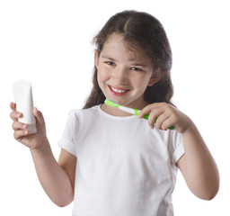 Little girl brushing teeth, isolated on white