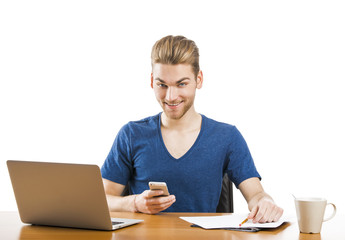 Young man sending text messages