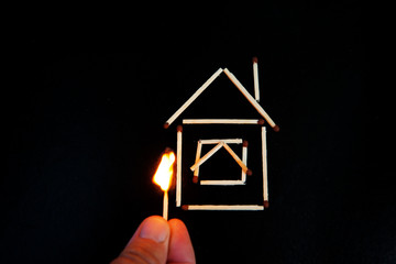 burning match inear the model of the house