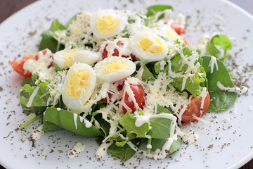 Delicious salad with eggs, cheese, tomatos cherry.