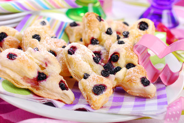 butterfly shaped puff pastry cookies with blueberry