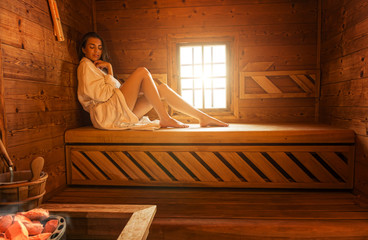 Pretty woman in sauna