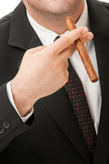 Cuban cigar, suit and tie.