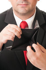 Businessman showing his empty wallet.