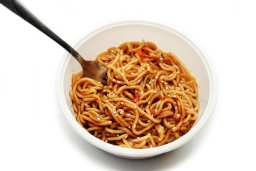 Eating Asian Noodles with Sesame Seeds with a Fork