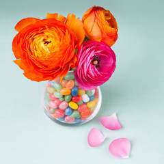 Ranunculus flowers with sweets