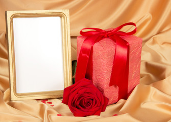 Empty photoframe with rose and gift
