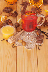 Cup of mulled wine with spices and honey
