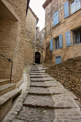 Narrow street in medieval town Gordes, southern France