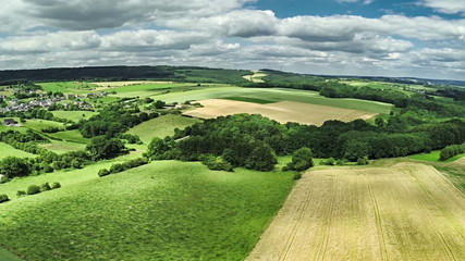 Aerial view of summer countryside with agricultural fields