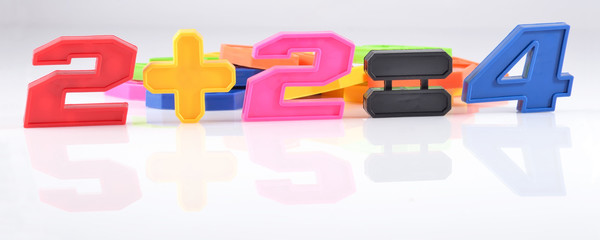 Colorful plastic numbers. Two plus two is four.