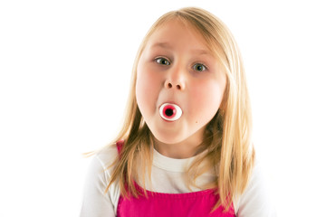 little girl with eye in her mouth