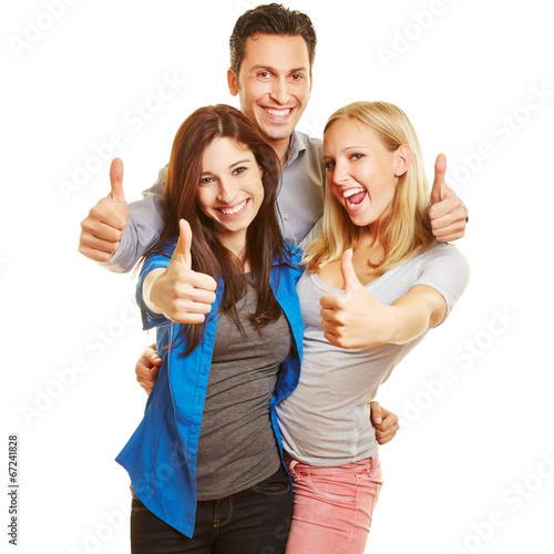 canvas print picture Drei junge Leute halten ihre Daumen hoch