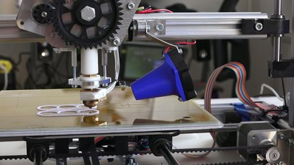 3d printer prints parts for homemade construction, side view