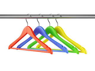 Colorful hangers on clothes rail