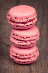 Macaroons on retro vintage wooden background